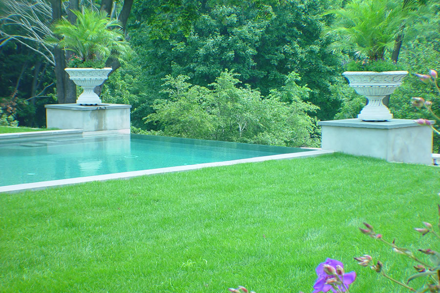 Contemporary Outdoor Pool Rumson, New Jersey with Negative Edge  Residential Pool Design by Omega Pool Structures, Inc