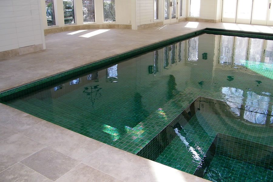 Indoor pool with custom tile residential pool design by for Residential pools