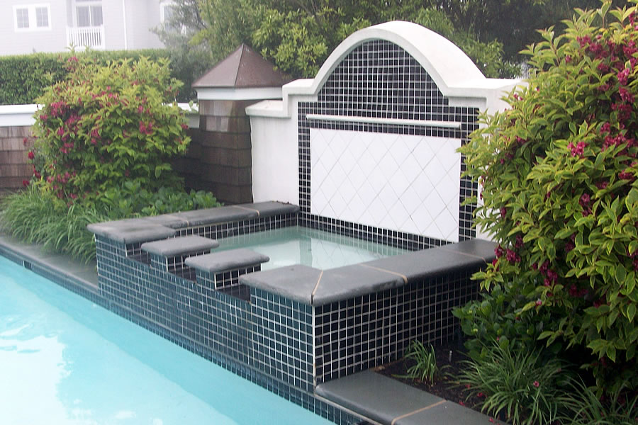 Outdoor Pool and Spa with Water Feature and Pool CoverResidential Pool Design by Omega Pool Structures, Inc